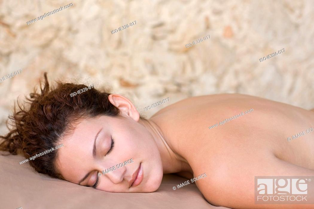 Stock Photo: Woman lying on front.
