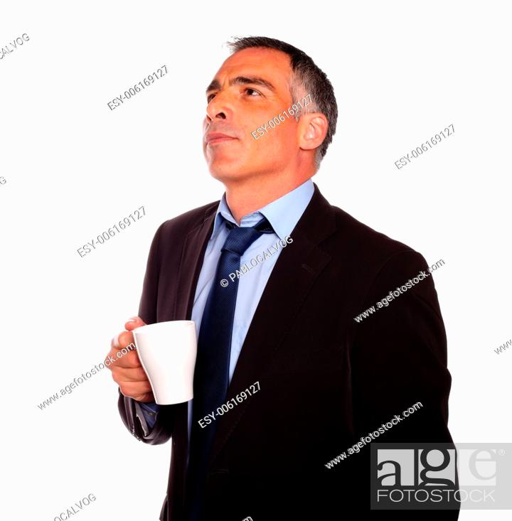 Stock Photo: Portrait of a reflective business man with a white mug on isolated background.