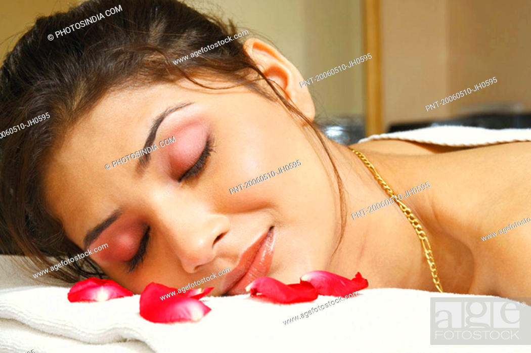 Stock Photo: Close-up of a young woman lying on a massage table.