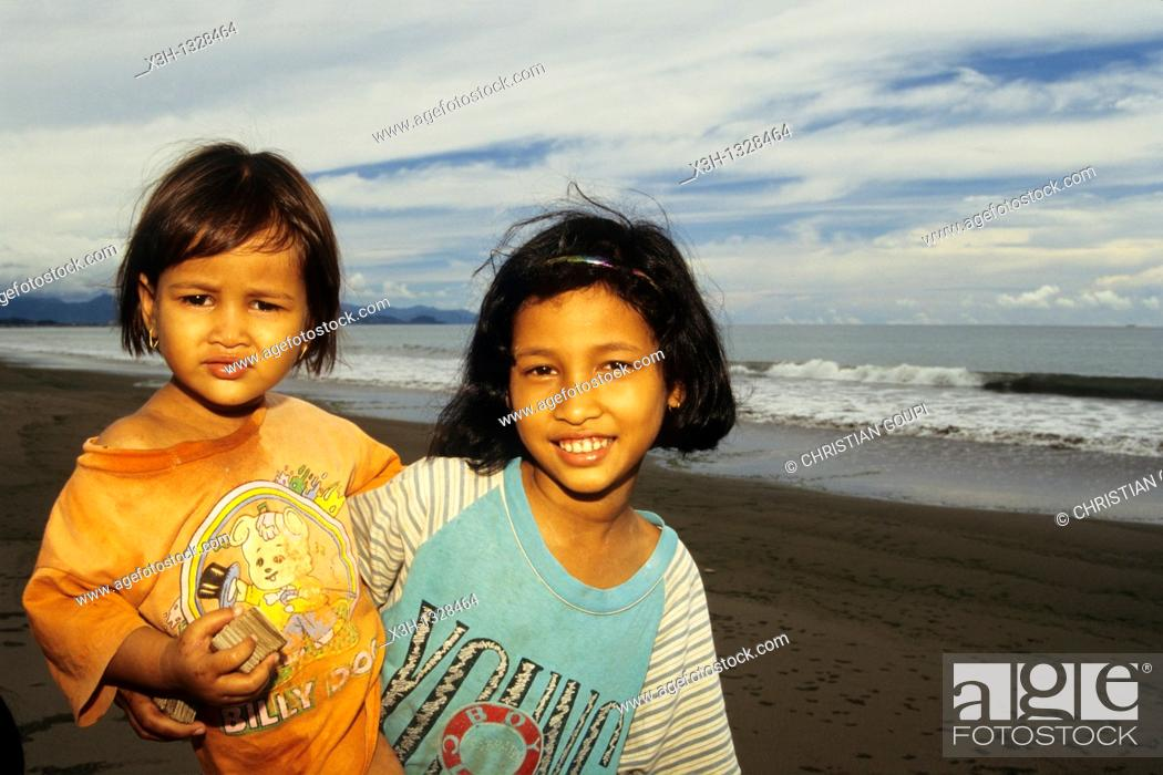 Stock Photo: little girl and baby on the beach, Sumatra island, Republic of Indonesia, Southeast Asia and Oceania.