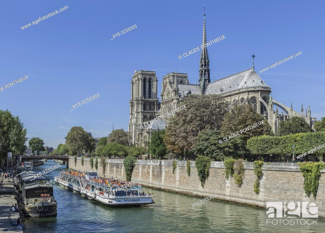 Stock Photo: Bateau-Mouche tour boat on the Seine river with Notre-Dame-de-Paris cathedral in the background, Paris, France.