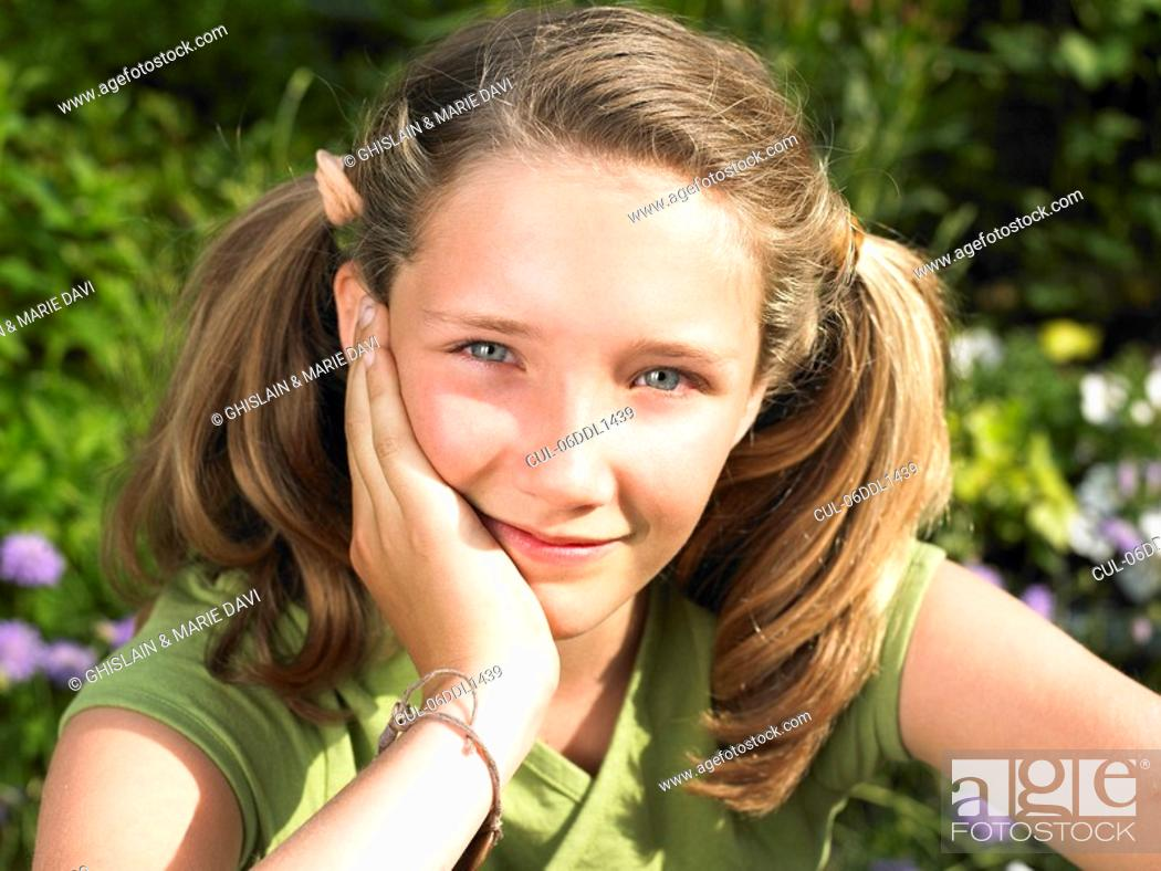 Stock Photo: Portrait of a girl, smiling.