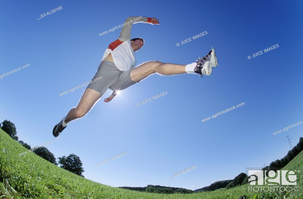 Stock Photo: Underview, man jumping.