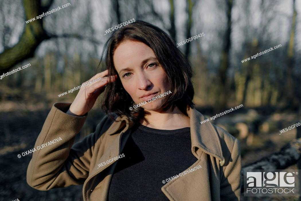 Stock Photo: Sunlight on beautiful woman in forest during spring.