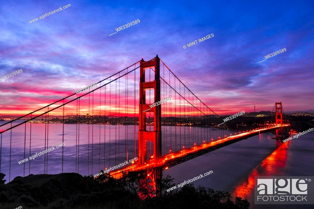 Stock Photo: Golden Gate Bridge lit up at sunset, San Francisco, California, United States.