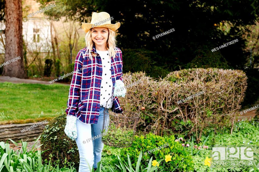 Stock Photo: Young woman gardening, basket.