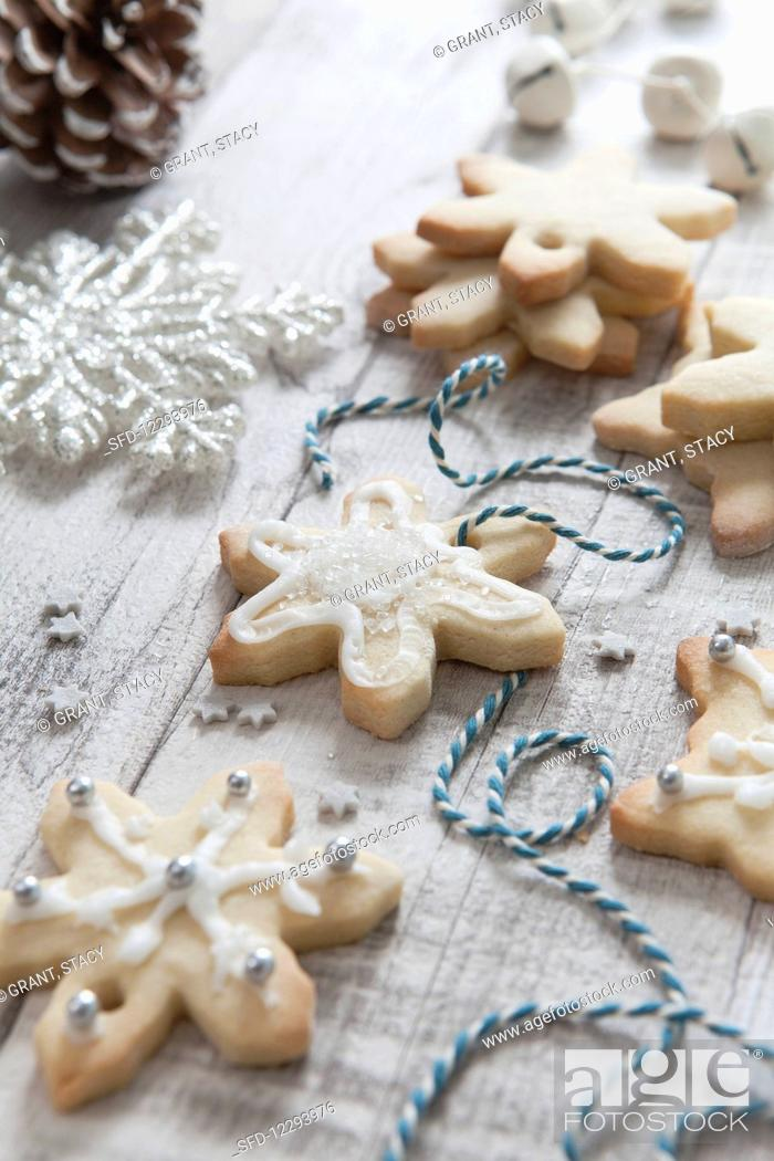 Iced Homemade Snowflake Shaped Christmas Biscuits Being Treaded With