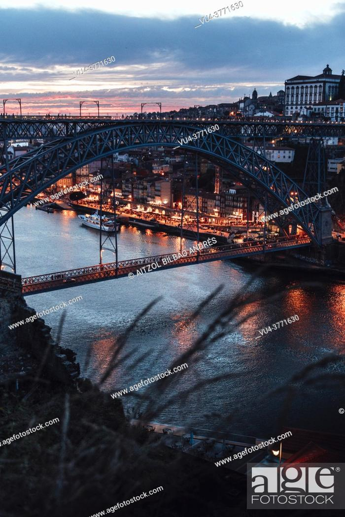 Stock Photo: Porto or Oporto is the second-largest city in Portugal and one of the Iberian Peninsula's major urban areas. . Night over the Douro Riber.