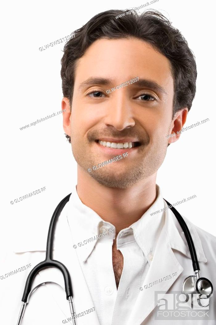 Stock Photo: Portrait of a male doctor smiling.