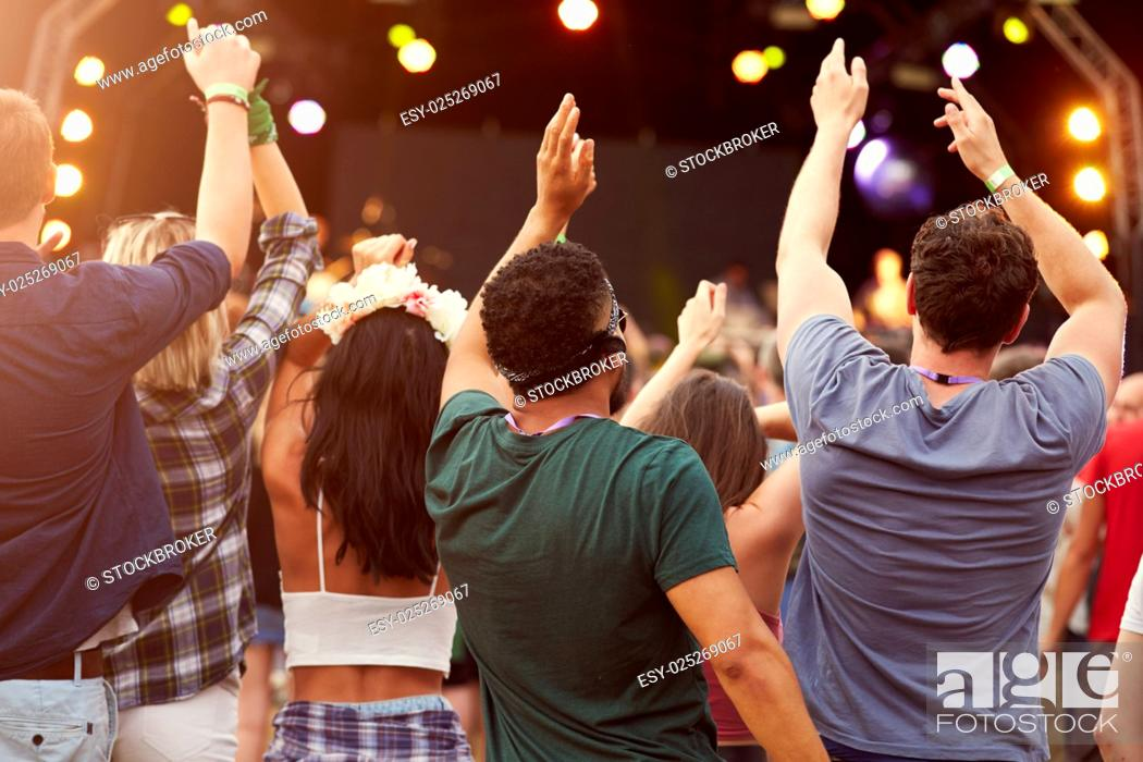 Stock Photo: Back view of audience at a music festival.