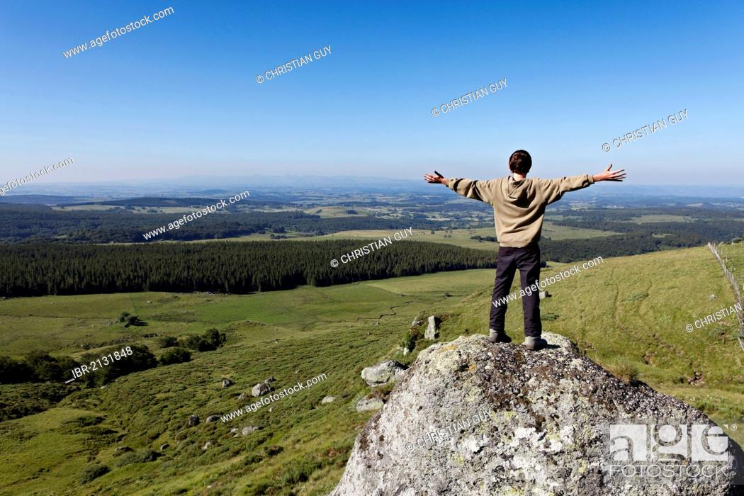 Stock Photo: Young hiker in Fontaine Salee reserve, Auvergne Volcanoes Natural Regional Park, massif of Sancy, Puy de Dome, Auvergne, France, Europe.