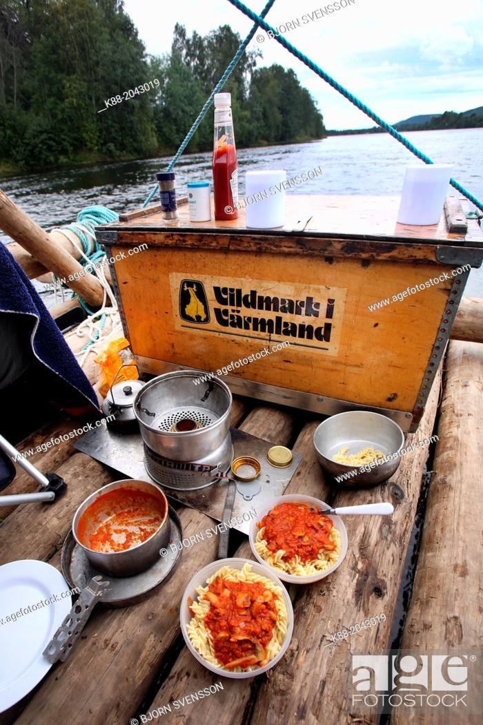 Stock Photo: Cooking onboard a timber raft on Klar Alven. Varmland, Sweden.