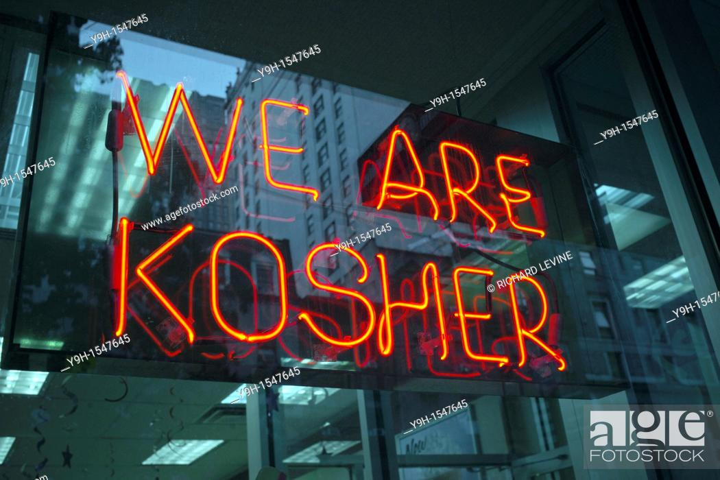 Stock Photo: A sign in the window of a Dunkin Donuts in New York advertises that they are kosher and observe dietary Jewish laws.