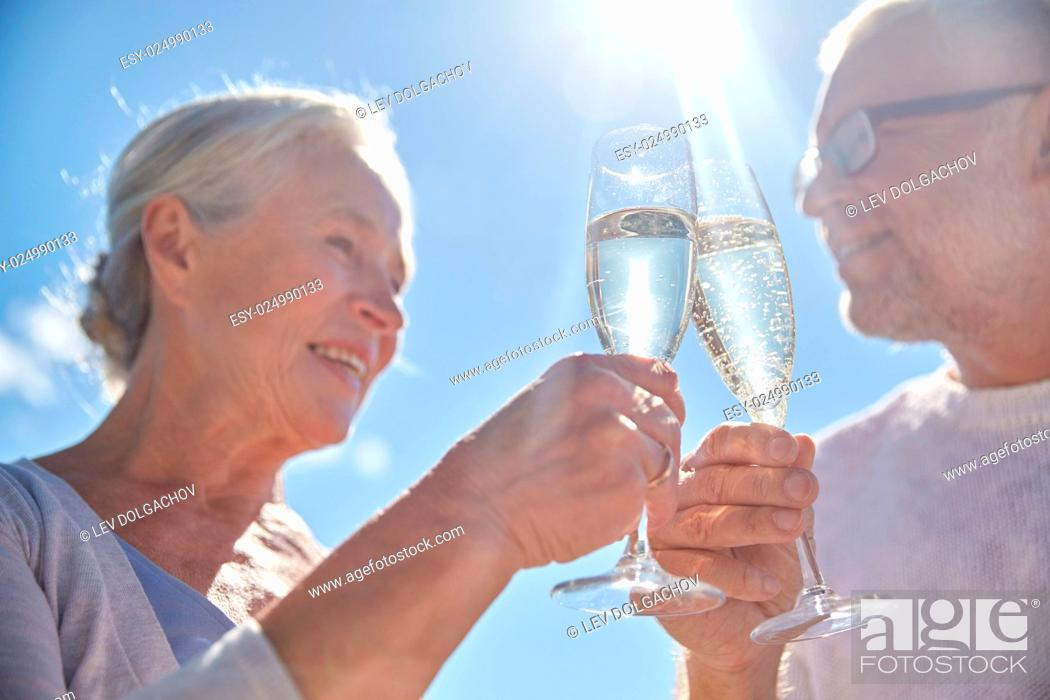 Stock Photo: family, age, holidays, leisure and people concept - close up of happy senior couple clinking champagne glasses on summer beach.