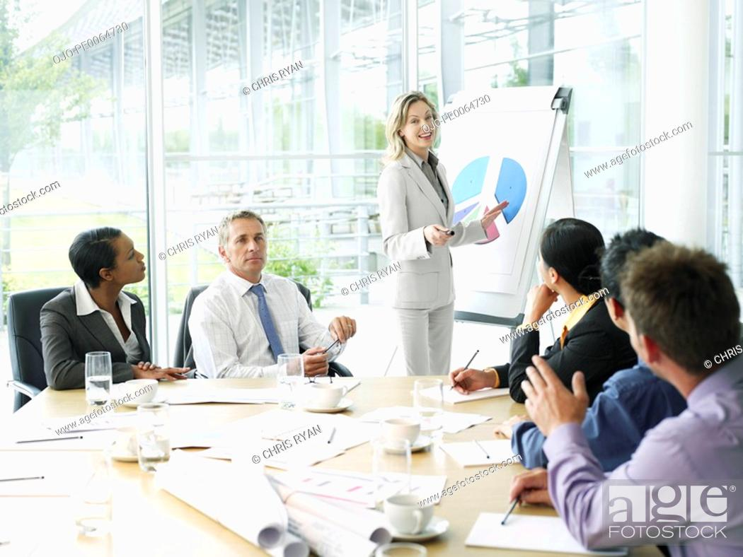 Stock Photo: Businesspeople having meeting in conference room.
