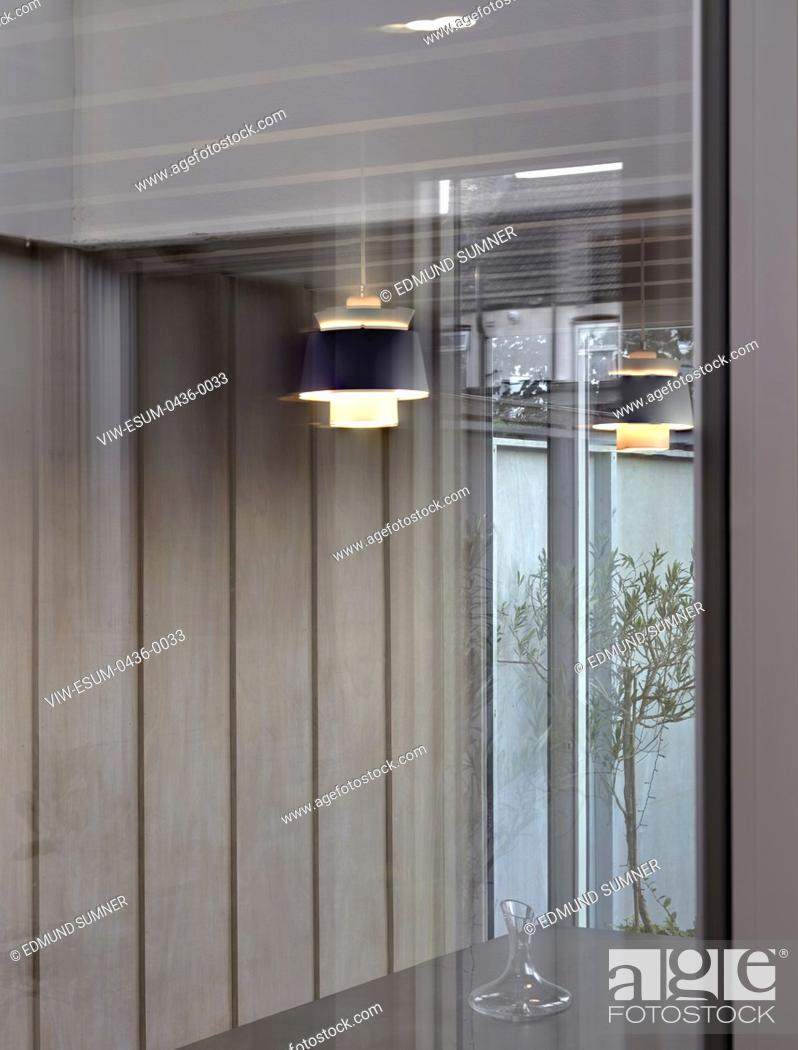 Stock Photo: Detail of dining space viewed through window. Ellis House, Ilford, United Kingdom. Architect: Buf Architects , 2019.
