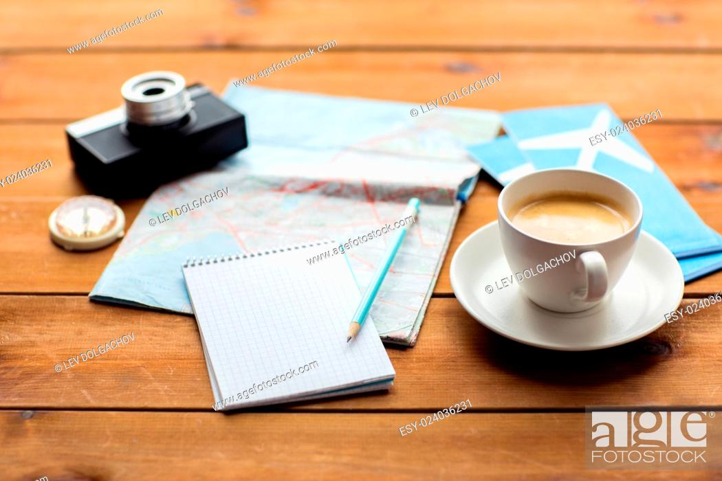 Stock Photo: vacation, tourism, travel and objects concept - close up of blank notepad with map, coffee and airplane tickets.