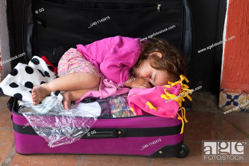 Stock Photo: Girl in a suitcase.
