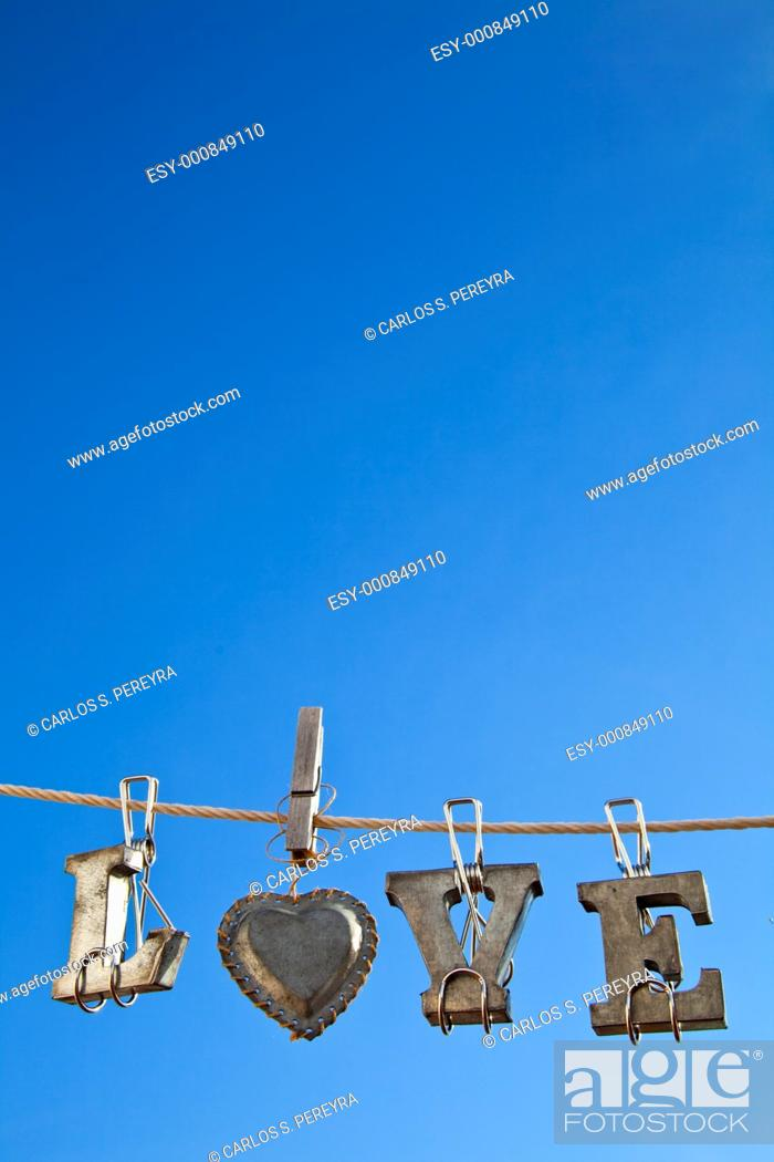 Stock Photo: message of love with metal letters.