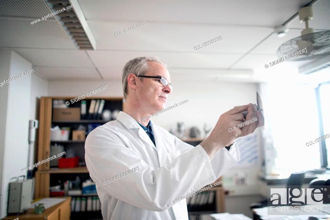 Stock Photo: Male meteorologist examining equipment in weather station laboratory.