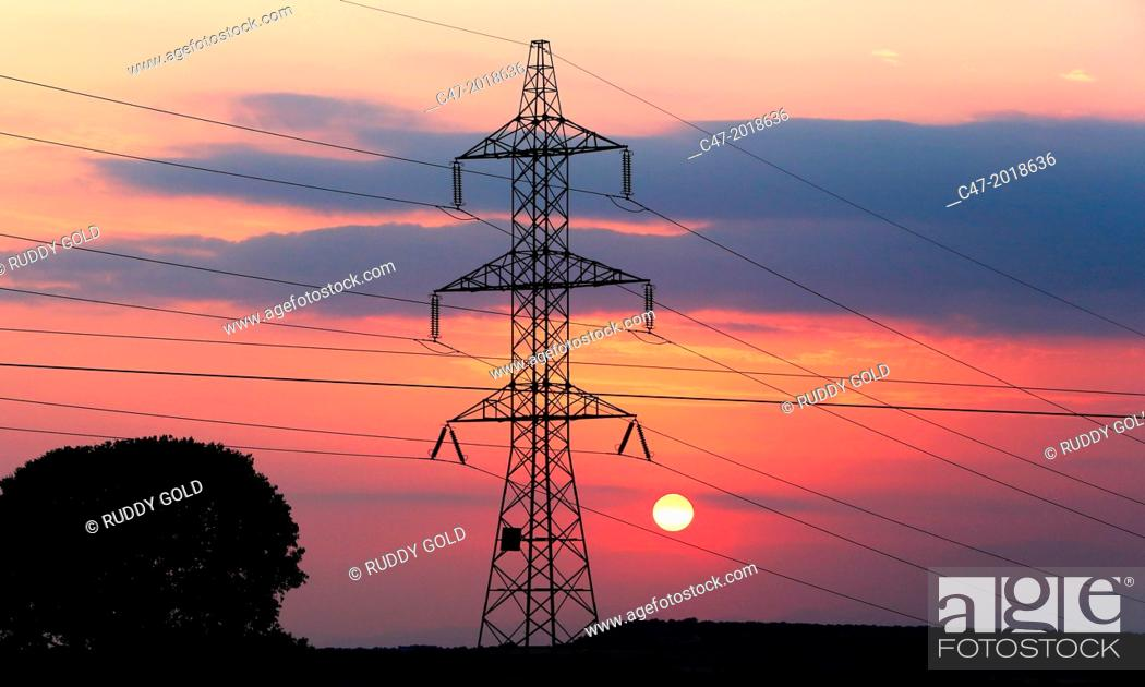 Stock Photo: High Voltage electricity transmission tower, electricity pylon, at sunset taken near Sanahuja on the la Segarra area, Lleida province, Catalonia, Spain.