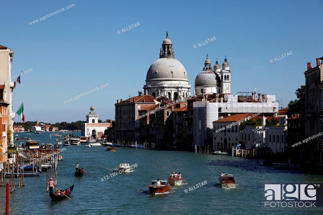 Stock Photo: SPEED BOATS & SANTA MARIA DELLA SALUTE ON GRAND CANAL; VENICE, ITALY; 11/09/2010.