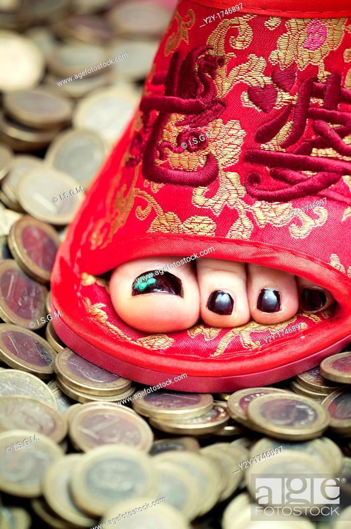 Stock Photo: Chinese feet on European money.