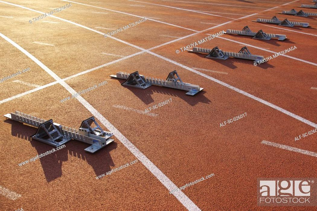 Stock Photo: Track and field starting blocks at starting line.