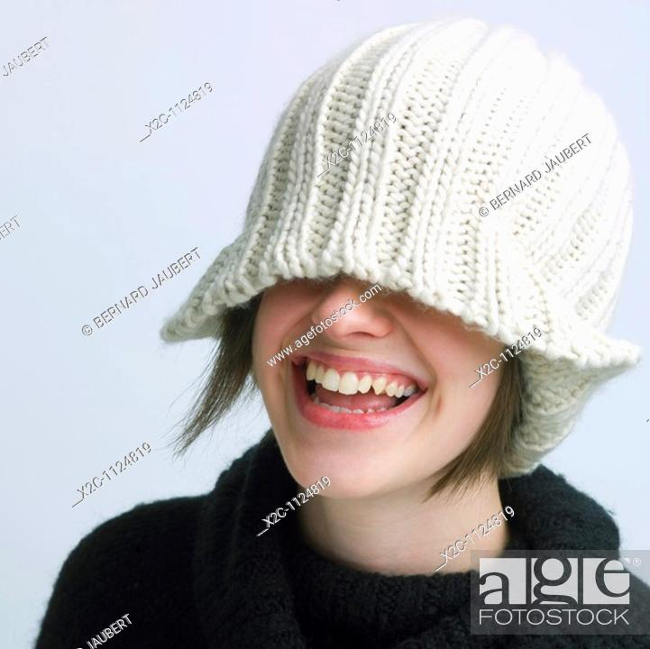 Stock Photo: Young woman wearing knitted hat.