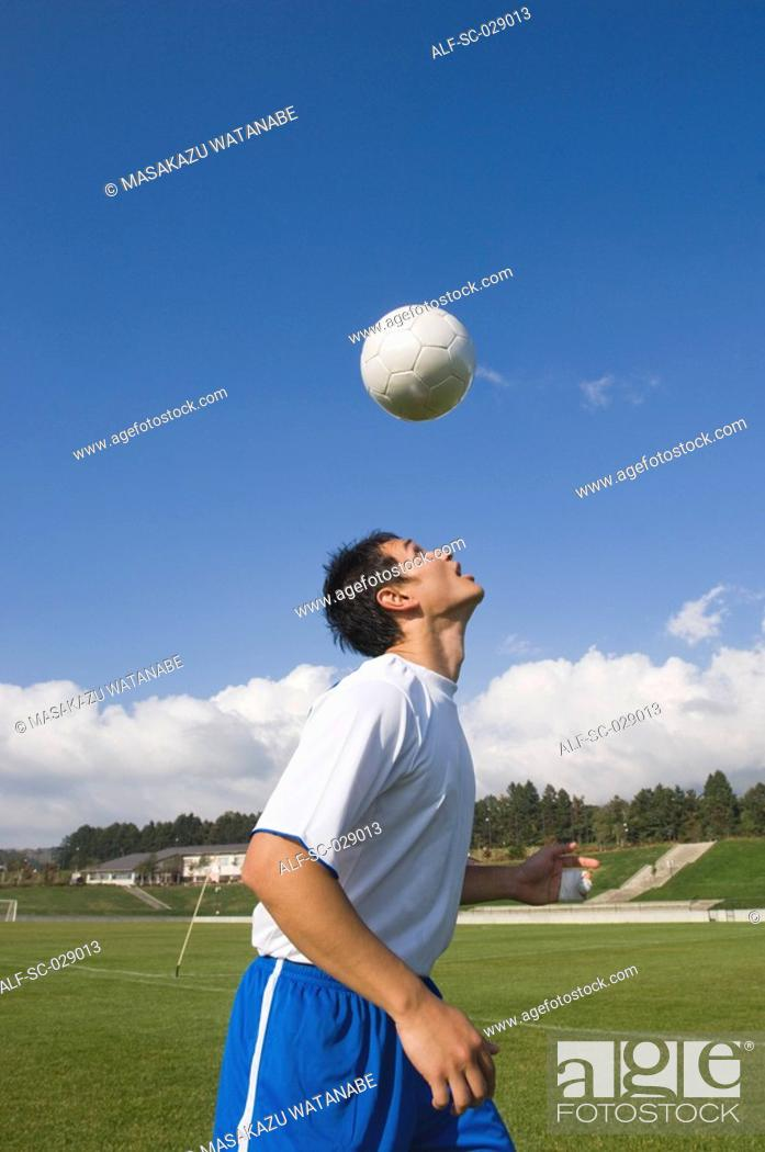 Stock Photo: Soccer Player Heading a Ball.