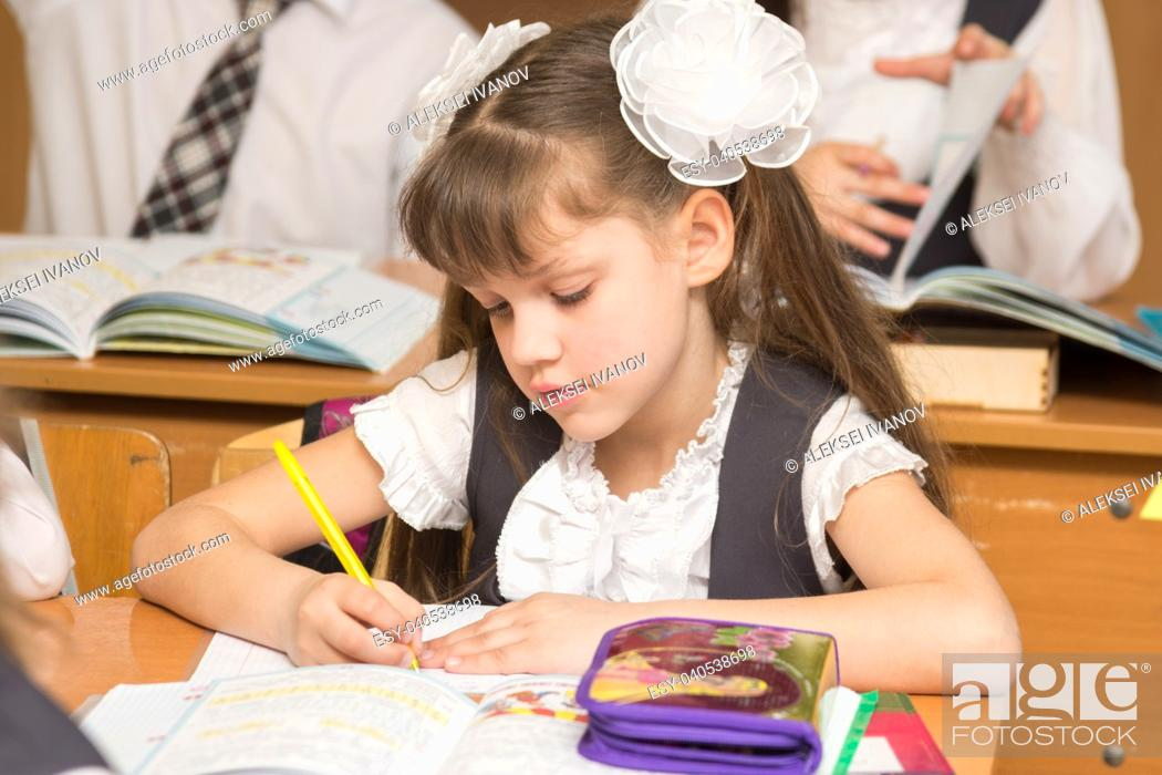 Stock Photo: First-grader in class at school.