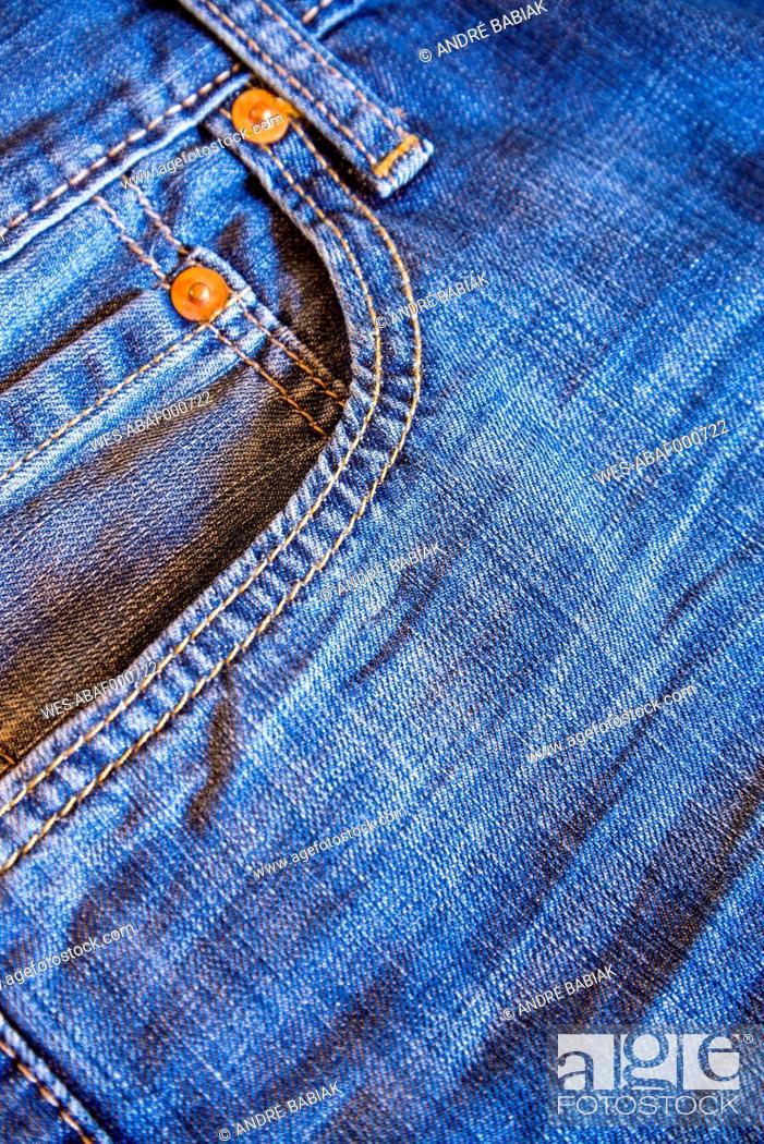 Stock Photo: Denim jeans pocket, close up.