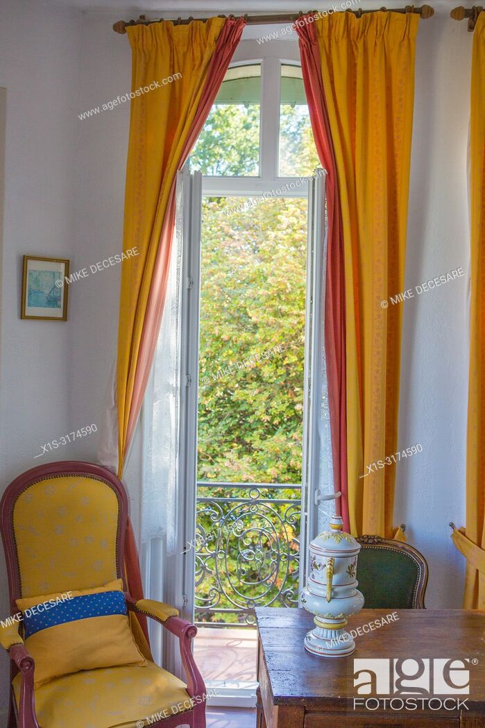 Stock Photo: A small, delightful and historic hotel once home to Renoir greets vistors who come to Grasse, France and stay at the Hotel la Bellaudere.