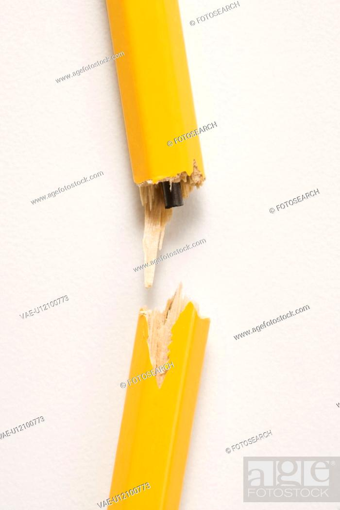Stock Photo: Wooden yellow pencil broken with lead exposed against white background.