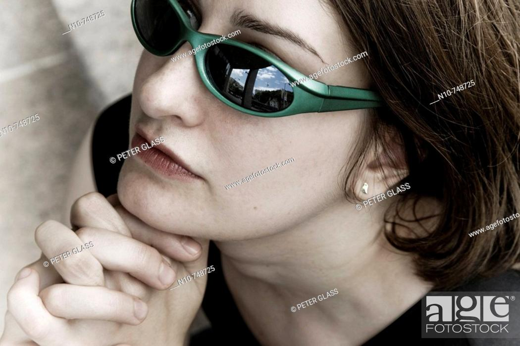 Stock Photo: Close-up of a young woman wearing sunglasses.