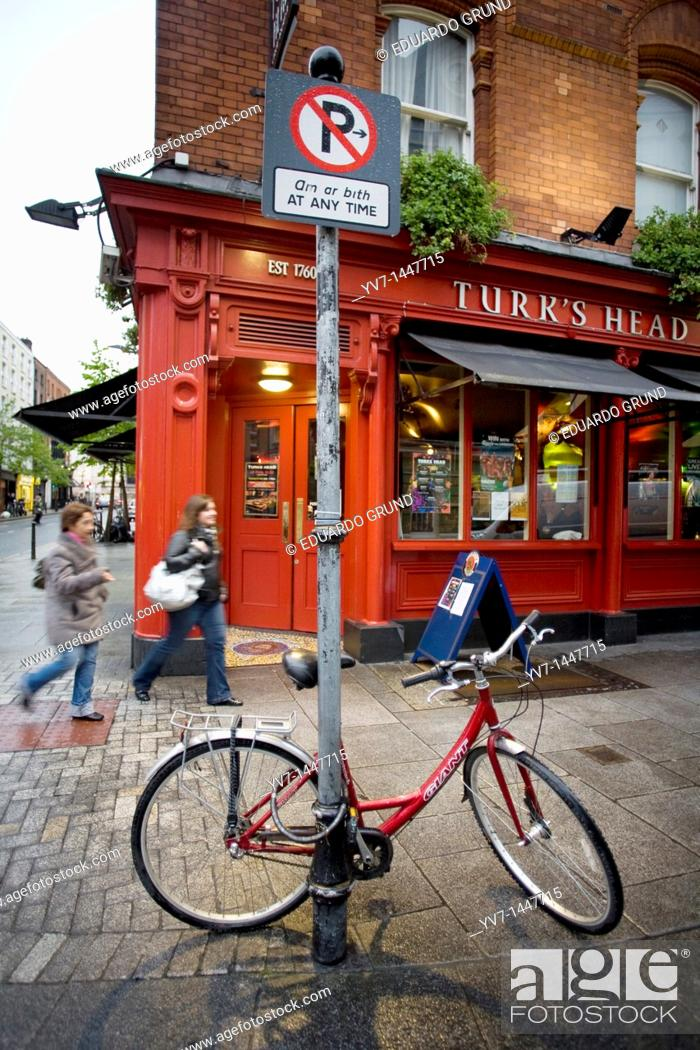 Stock Photo: Constrast between the flashy colours of the pubs, and the called 'soft rain' in Dublin  Dublin, Leinster, Ireland, Europe.