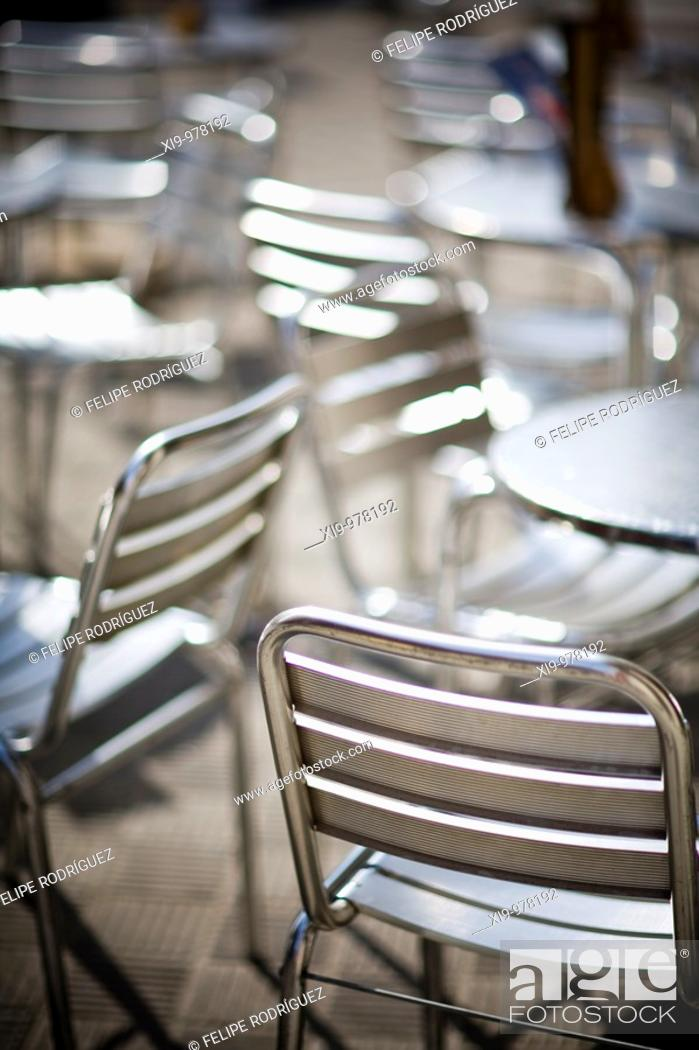 Stock Photo: Metallic seats and tables of an outdoor restaurant, Seville, Spain.