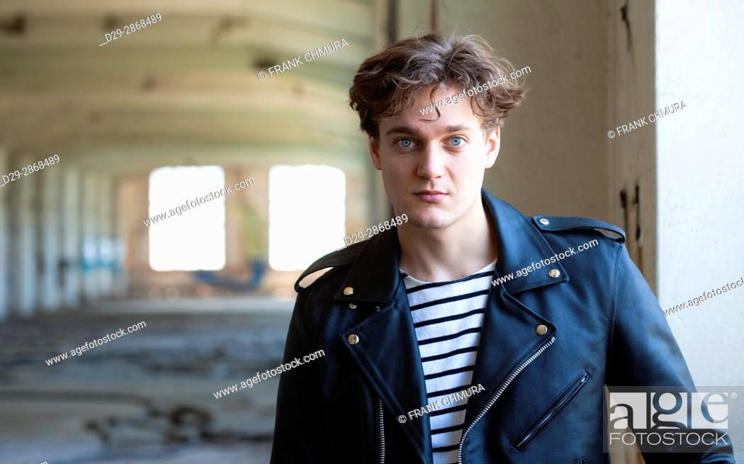 Stock Photo: Portrait of a Young Man in Abandon Building.