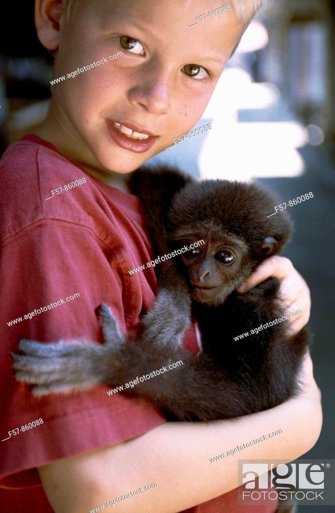 Stock Photo: Boy with a baby manokey in Koh Samui, Thailand.