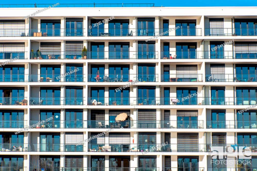 Stock Photo: Facade of a modern apartment building with a lot of balconies seen in Hamburg, Germany.