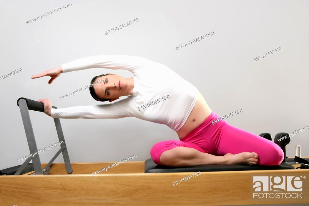 Stock Photo: gym woman pilates stretching sport in reformer bed instructor girl.
