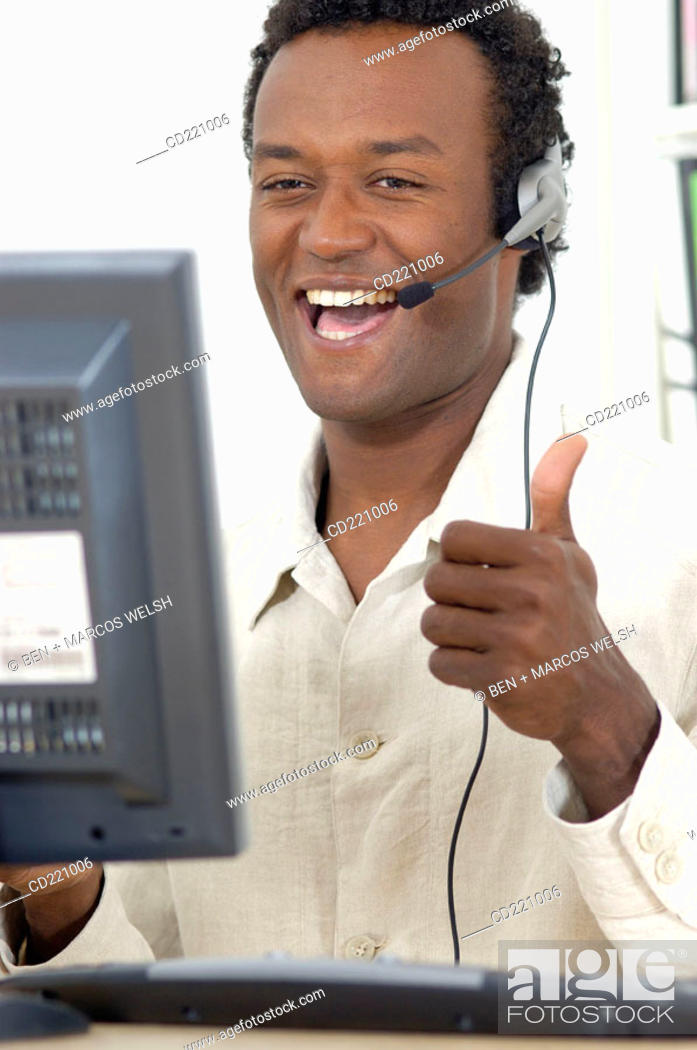 Stock Photo: Black man, telemarketing, happy.
