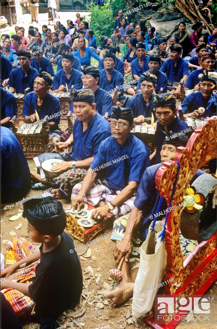 Stock Photo: Asia, Bali, Asia, Denpasar, Gamelan Orchestra, Indonesia, cremation ceremony, music, musician, no model release.