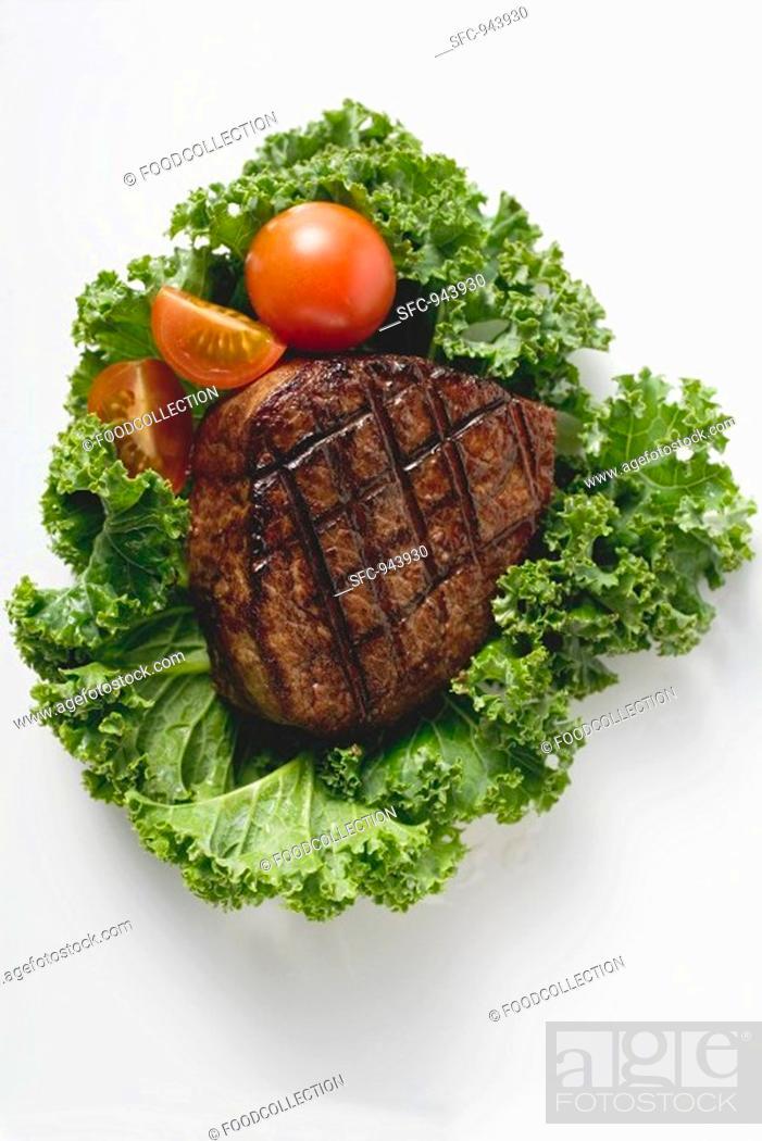 Stock Photo: Grilled fillet steak on lettuce leaf.