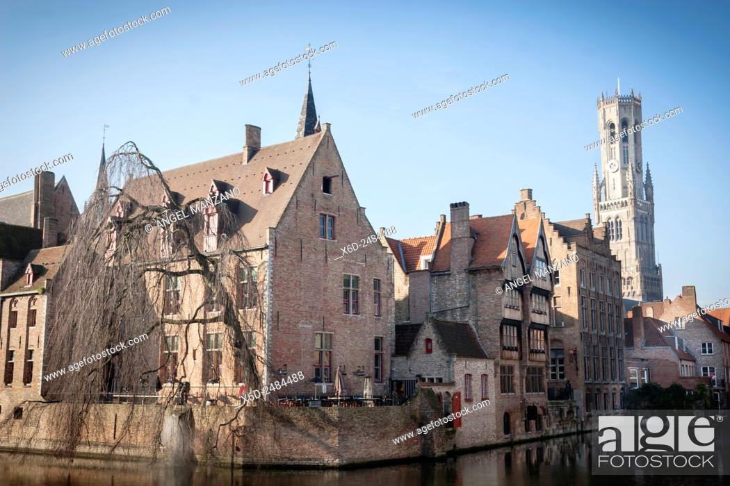 Stock Photo: Belfry of Bruges towers over the buildings at the junction of the Groenerei and Dijver canals, Bruges, Belgium.