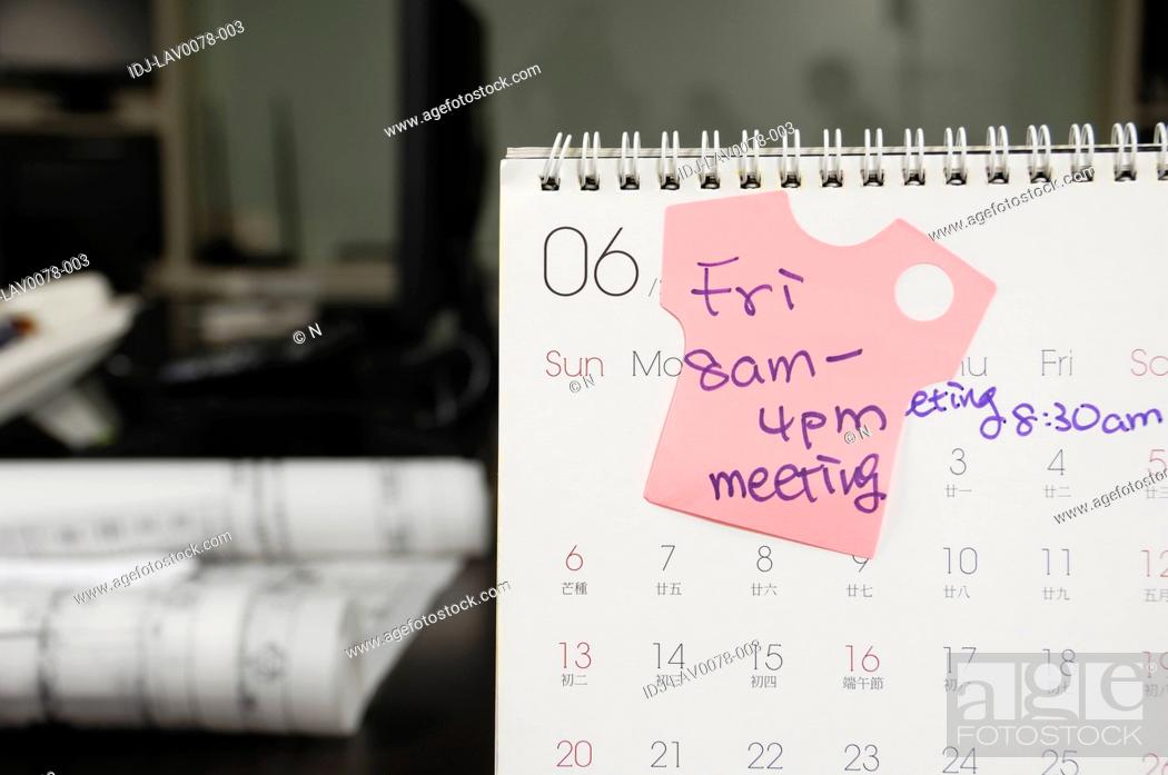 Stock Photo: Adhesive note stuck on a calendar.