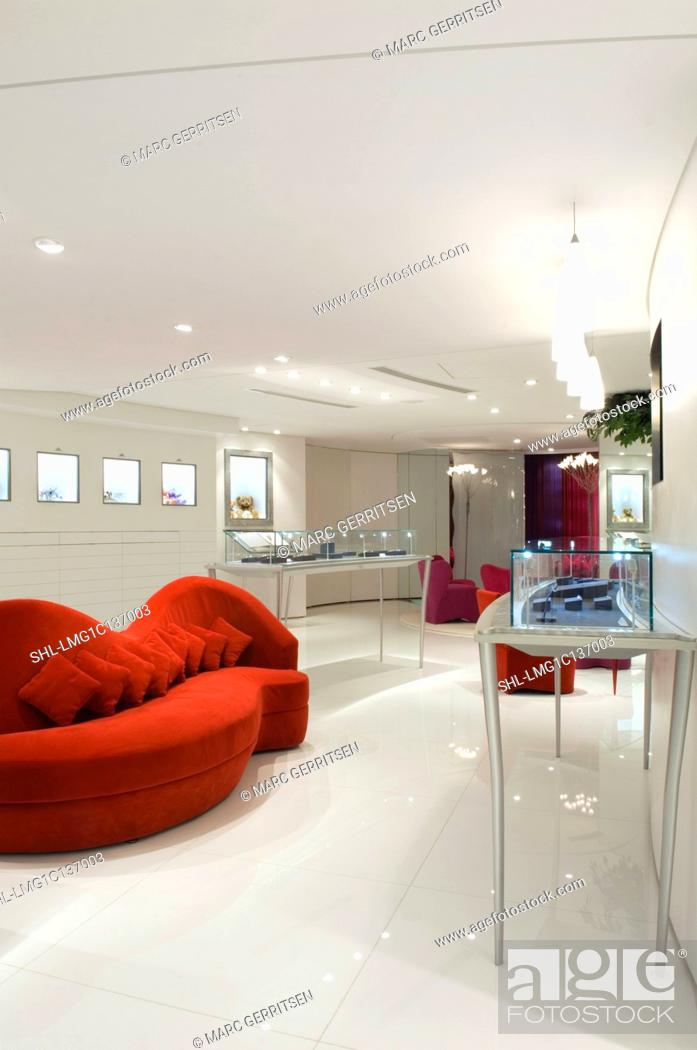 Stock Photo Red Sofa And Jewelry Displayed In Gl Cabinets