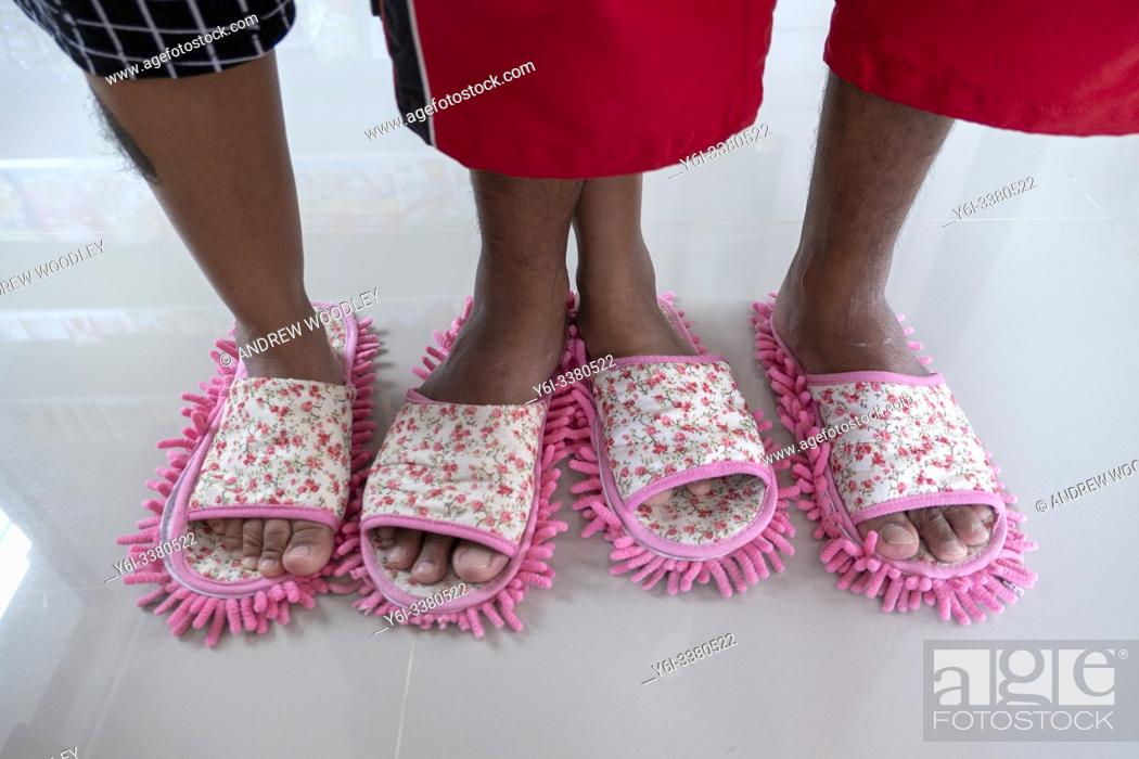 Stock Photo: Store owners use floor cleaning slippers at beach shop. Ko Tao, Thailand.