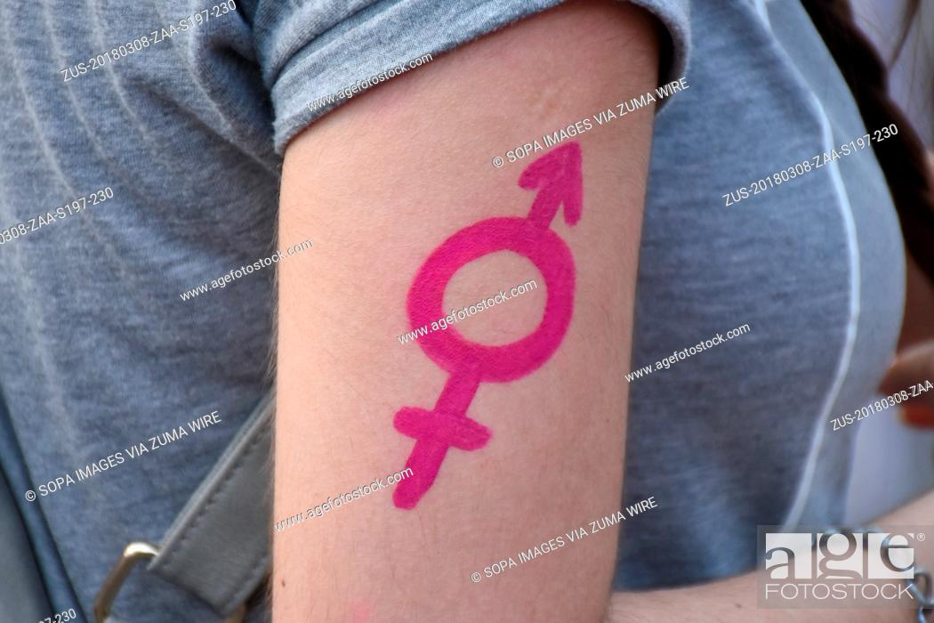 Stock Photo: March 8, 2018 - Mexico City, Mexico, Mexico - A symbol representing male/female seen during the protest. Women from various organizations gathered at 'Angel de.