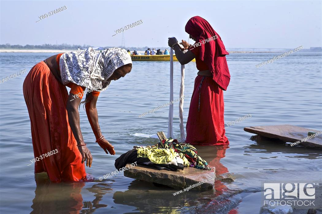 Stock Photo: hindu women washing saris and other fabrics on ghats in benares, up, india.